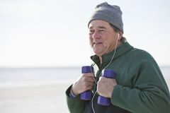 Mature man exercising with hand weights outdoors Royalty Free Stock Photography