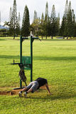 Man circuit training in park, Hawaii Royalty Free Stock Photography