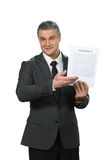 Mature man explains brighter prospects. Executive showing the contract. Recruiting new man. Think and decide. Mature man explains brighter prospects Royalty Free Stock Images