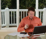 Mature man expressing Joy while working from home Royalty Free Stock Photos