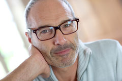 Mature man with eyeglasses looking at camera Royalty Free Stock Images