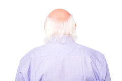 Mature man facing the wall Stock Images