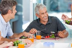 Mature man with family dinner table Royalty Free Stock Images