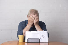 Mature man with with finance issues Royalty Free Stock Photos