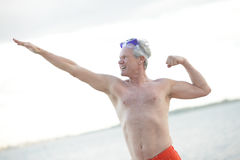 Mature man in a fitness pose Royalty Free Stock Photography