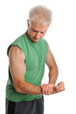 Mature Man Flexing Arm. Isolated over white background Stock Image