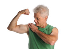 Mature Man Flexing Biceps. Portrait of mature man flexing biceps isolated over white background Stock Photos