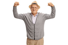 Mature man flexing his biceps Royalty Free Stock Photography
