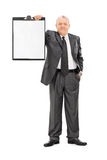 Mature man in formalwear holding a clipboard Royalty Free Stock Image