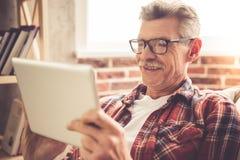 Mature man with gadget Stock Photo