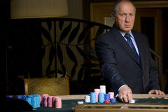 Mature man gambling, hand on chips, portrait Royalty Free Stock Photos