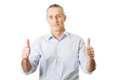Mature man gesturing ok sign. Smiling mature man gesturing ok sign Royalty Free Stock Image