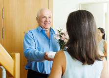 Mature man giving jewel in box to woman Stock Images