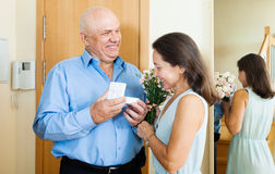 Mature man giving present to  woman Stock Images