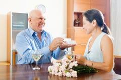Mature man giving  woman the jewel Royalty Free Stock Photos