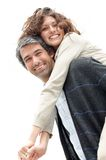 Mature man giving woman piggyback ride Stock Photos