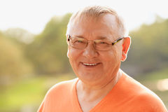 Mature man in glasses outdoor Stock Photo