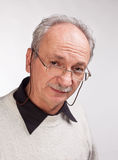 Mature man with glasses and a white sweater Stock Image