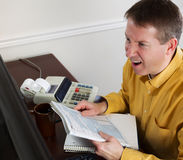 Mature Man goes into rage while work on his Taxes Royalty Free Stock Photos