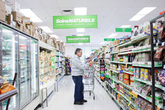 Mature man in grocery store. Montreal Quebec (canada) Mature man in grocery store stock image