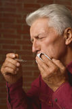 Mature man had s toothache. Close up Royalty Free Stock Photography