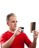 The mature man has reflected on application of a man cream against wrinkles Stock Images
