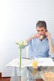 Mature Man Having Breakfast Stock Photo