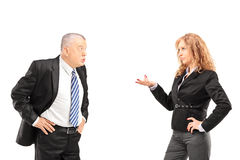 Mature man having a disagreement with a woman. Mature men having a disagreement with a women isolated on white background Royalty Free Stock Images