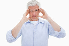 Mature man having a headache Royalty Free Stock Photography