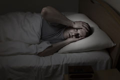 Mature Man having trouble Sleeping Stock Photography