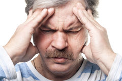 Mature man having very strong pain isolated. On white background stock images