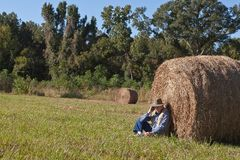 Mature man and hay stack Stock Photo