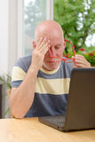 Mature man with headache Royalty Free Stock Image