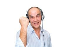 Mature man in headphones Stock Photography