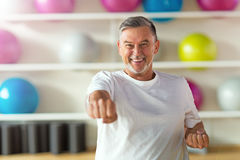 Mature man in health club Royalty Free Stock Photography