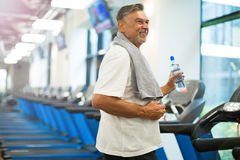 Mature man in health club Stock Photos