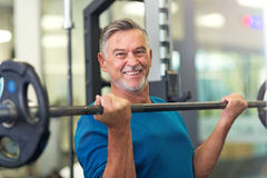 Mature man in health club Royalty Free Stock Photos
