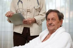 Mature man at health control Royalty Free Stock Photos