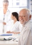 Mature man on health control smiling Royalty Free Stock Image