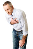 Mature man with heart disease Royalty Free Stock Photo
