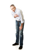 Mature man with heart disease. Bending Royalty Free Stock Photography