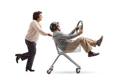 Mature man with a helmet and a steering wheel riding inside a sh Royalty Free Stock Image
