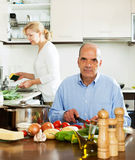 Mature man helping his wife in household work Stock Photography