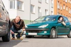 Mature man helping woman with her car Stock Photos