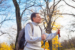 Mature man  hiker. Mature backpacker in an autumn forest Royalty Free Stock Images