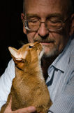 Mature man with his cat Royalty Free Stock Image