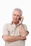 Mature man with his cellphone Stock Images