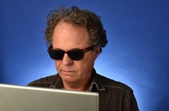 Mature Man on his computer Royalty Free Stock Photo