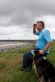 Mature man  and his dog Royalty Free Stock Image