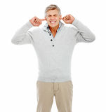 Mature man with his fingers in his ears Stock Image